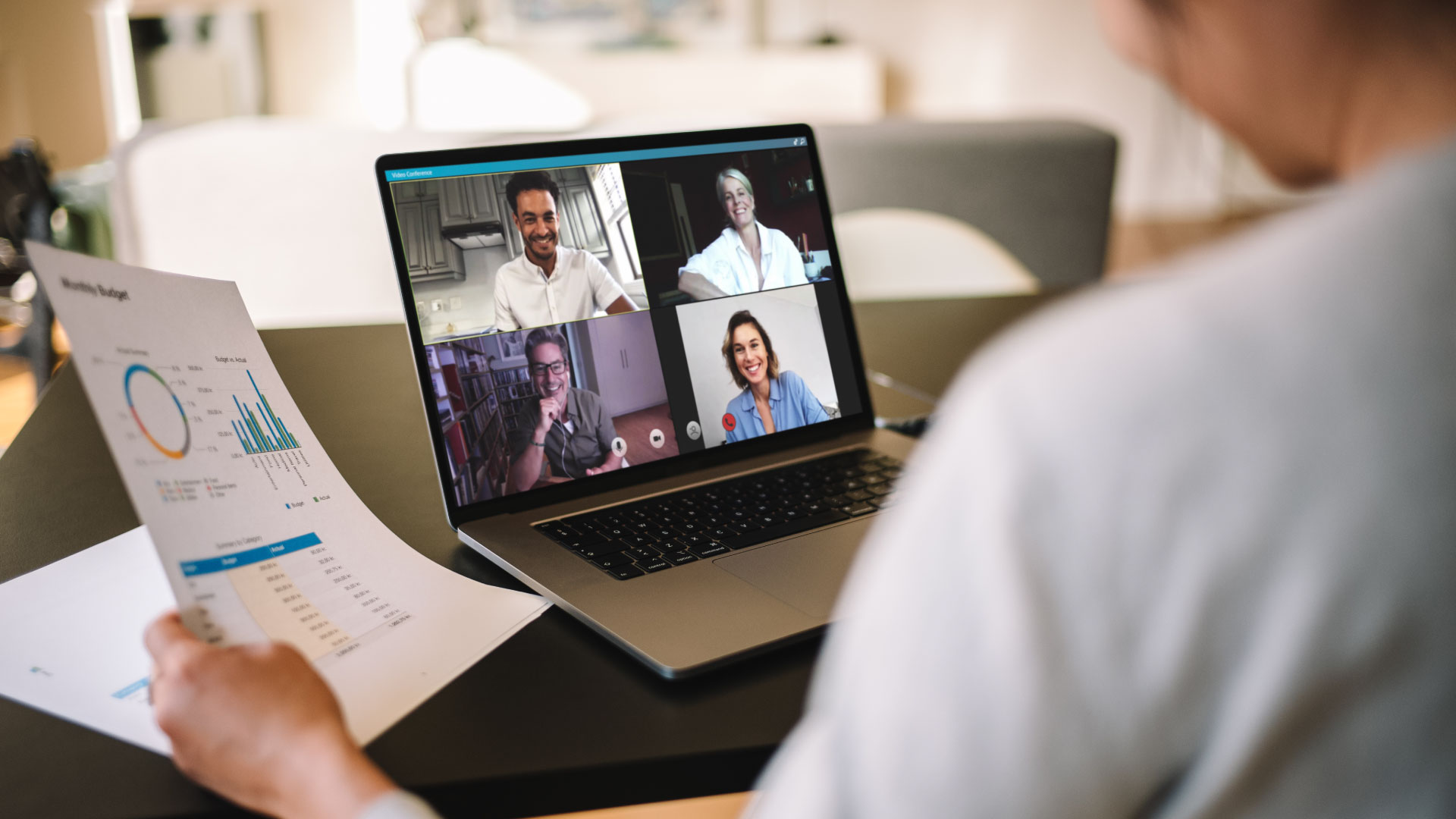 People having remote meeting via video conference