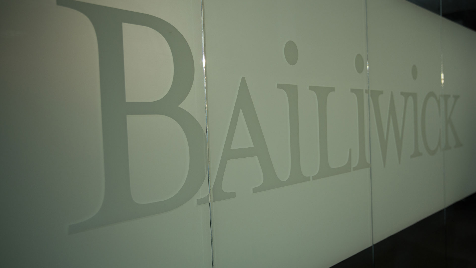 Etched Bailiwick logo on glass windows