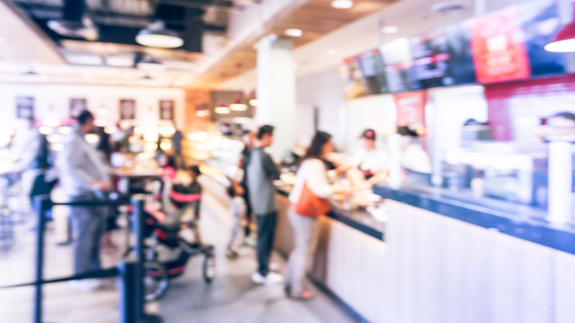 Blurred picture of people ordering food at quick serve restaurant